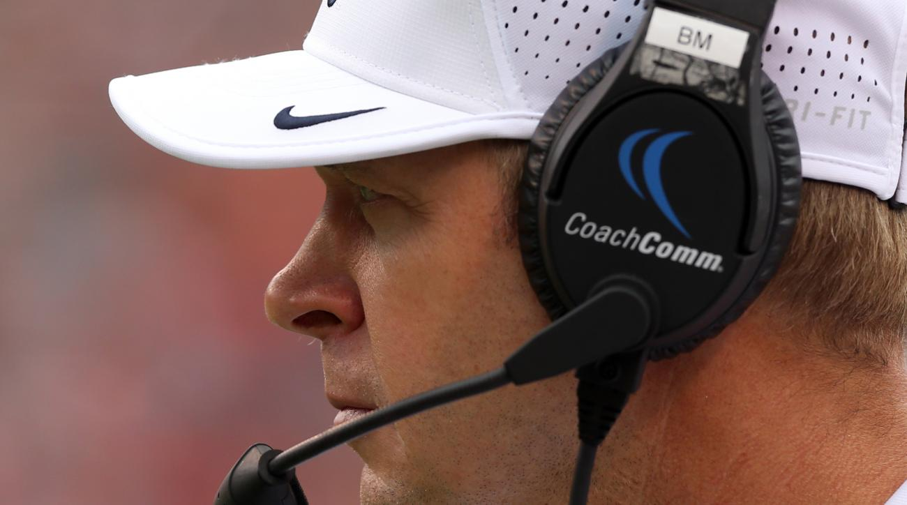 Virginia head coach Bronco Mendenhall watches a play during the second half of an NCAA football game against Richmond,  Saturday Sept. 3, 2016, in Charlottesville, Va. Richmond defeated Virginia  37-20. (AP Photo/Andrew Shurtleff)