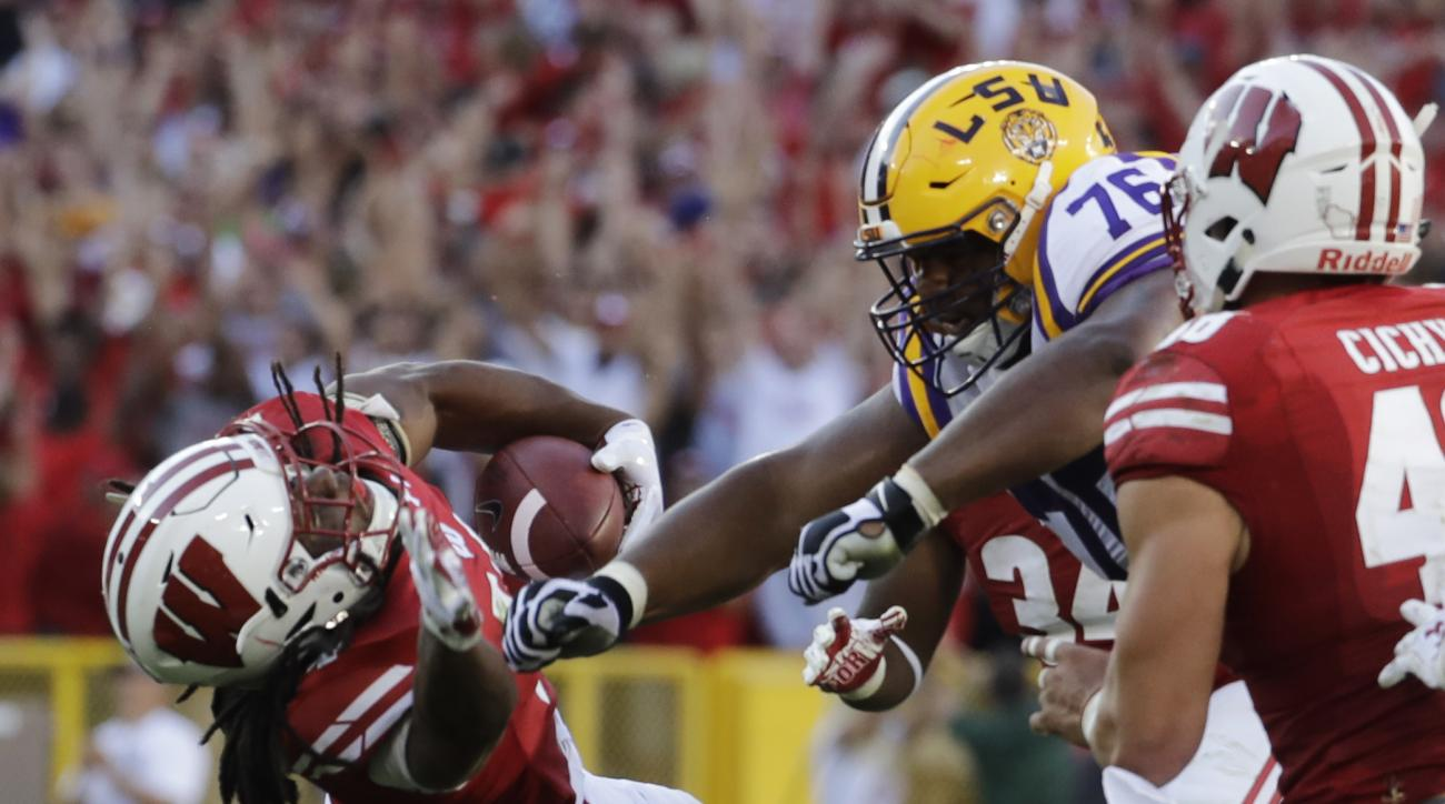 LSU's Josh Boutte hits Wisconsin's D'Cota Dixon after Dixon intercepted a pass during the second half of an NCAA college football game Saturday, Sept. 3, 2016, in Green Bay, Wis. Boutte was ejected from the game on the play. Wisconsin won 16-14. (AP Photo