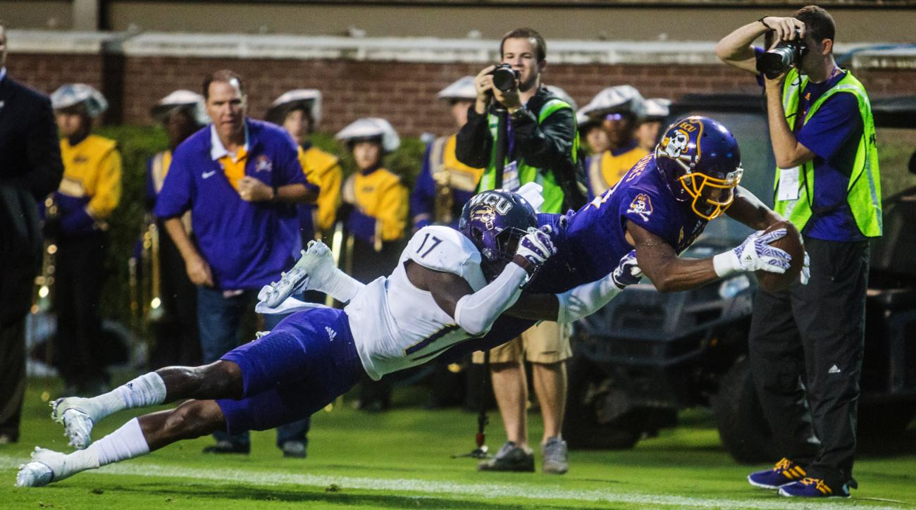 Eastern Carolina's Zay Jones dives into the end zone tailed by Western Carolina's Tra Hardy during an NCAA college football game in Greenville, N.C., Saturday, Sept. 3, 2016. (Joe Pellegrino/The Daily Reflector via AP)