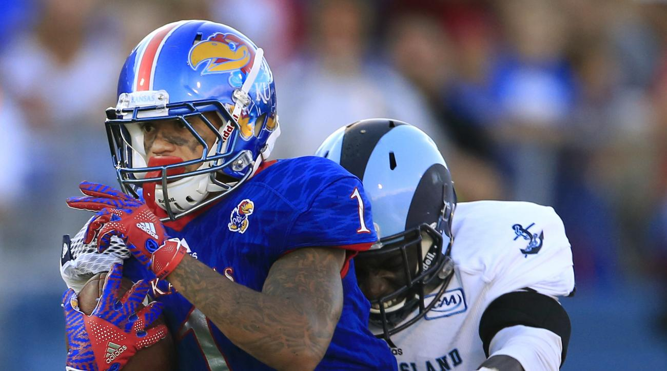 Kansas wide receiver LaQuvionte Gonzalez (1) makes a catch while covered by Rhode Island defensive back Abdul Ibrahim (5) during the first half of an NCAA college football game in Lawrence, Kan., Saturday, Sept. 3, 2016. (AP Photo/Orlin Wagner)