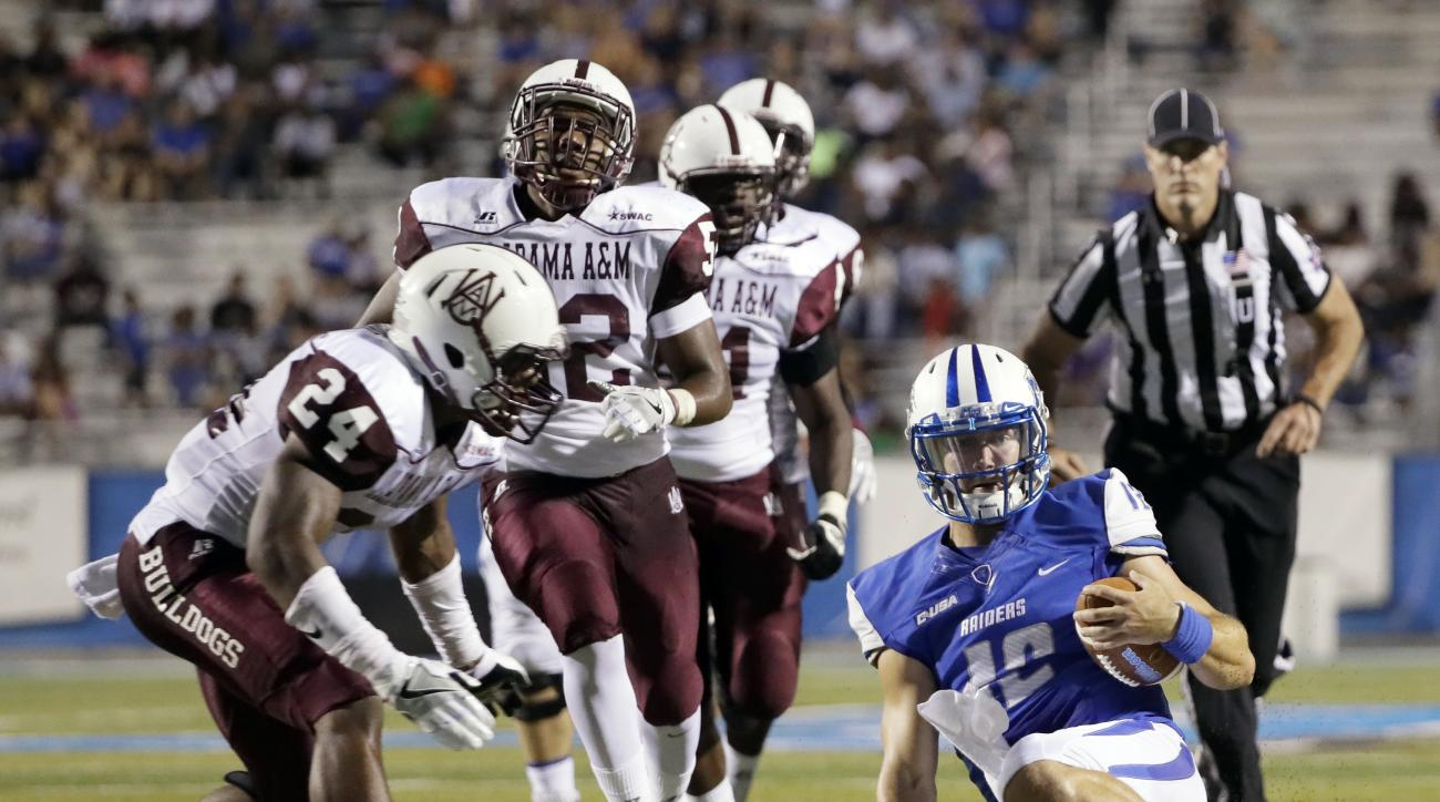 Middle Tennessee quarterback Brent Stockstill (12) slides as Alabama A&M defensive back Justin Brown (24) closes in during the first half of an NCAA college football game Saturday, Sept. 3, 2016, in Murfreesboro, Tenn. (AP Photo/Mark Humphrey)