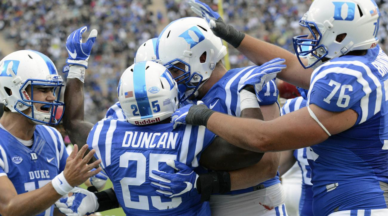 Duke's Jela Duncan (25) celebrates his touchdown with Duke quarterback Daniel Jones, left, Casey Blaser and Gabe Brandner (76) during an NCAA college football game, Saturday Sept. 3, 2016, in Durham, N.C. (Bernard Thomas/The Herald-Sun via AP)
