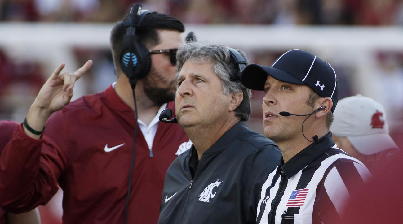 Washington State head coach Mike Leach, center, watches a replay during the first half of an NCAA college football game against the Eastern Washington in Pullman, Wash., Saturday, Sept. 3, 2016. (AP Photo/Young Kwak)