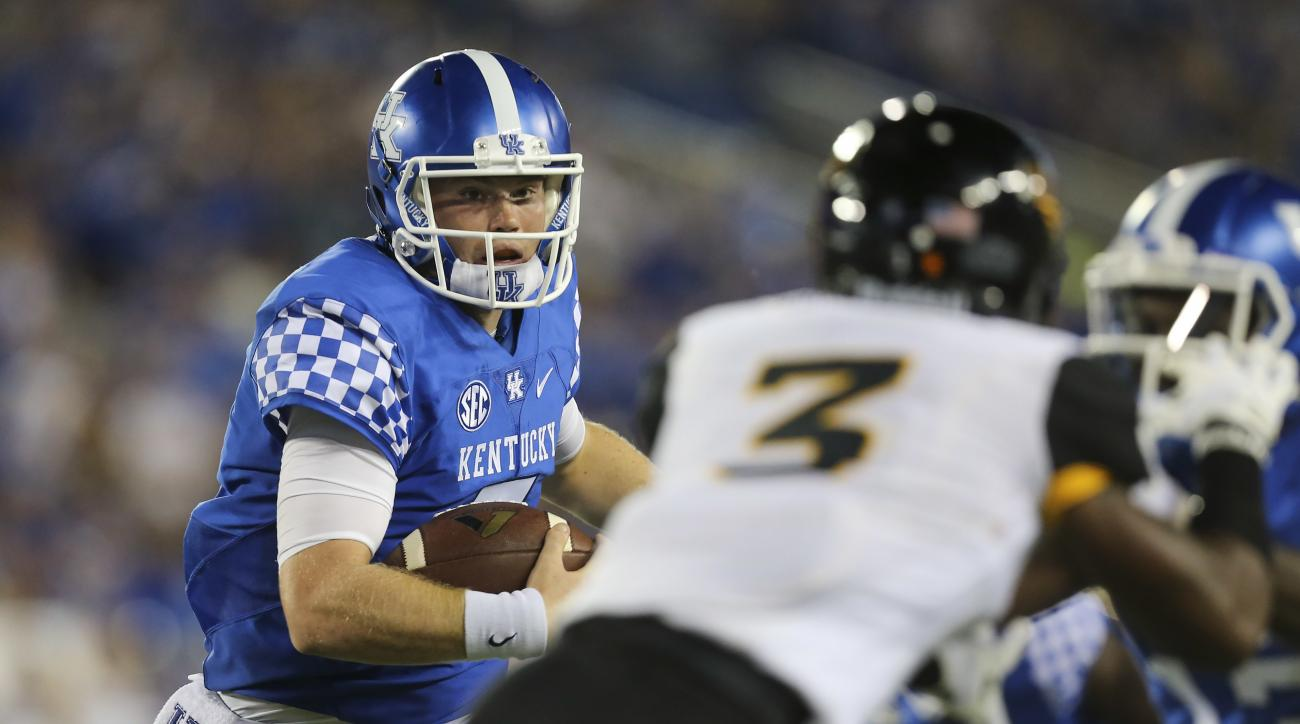 Kentucky quarterback Drew Barker runs with the ball to set up a touchdown late in the first half of an NCAA college football game against Southern Mississippi, Saturday, Sept. 3, 2016, in Lexington, Ky. (AP Photo/David Stephenson)