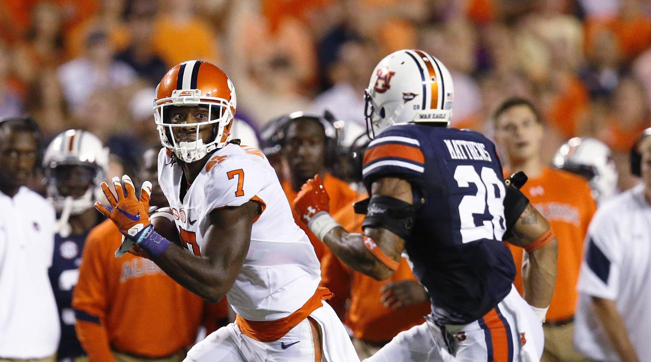 Clemson wide receiver Mike Williams carries the ball aast Auburn defensive back Tray Matthews pursues during the first half of an NCAA college football game, Saturday, Sept. 3, 2016, in Auburn, Ala. (AP Photo/Brynn Anderson)