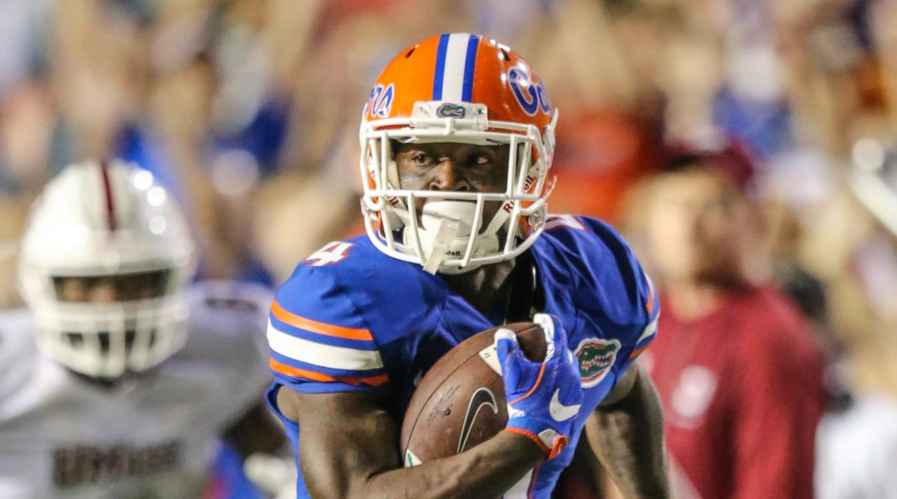 Florida wide receiver Brandon Powell (4) runs the ball after a catch for a touchdown against Massachusetts during the fourth quarter of an NCAA college football game in Gainesville, Fla., Saturday, Sept. 3, 2016. (Gary McCullough/The Gainesville Sun via A