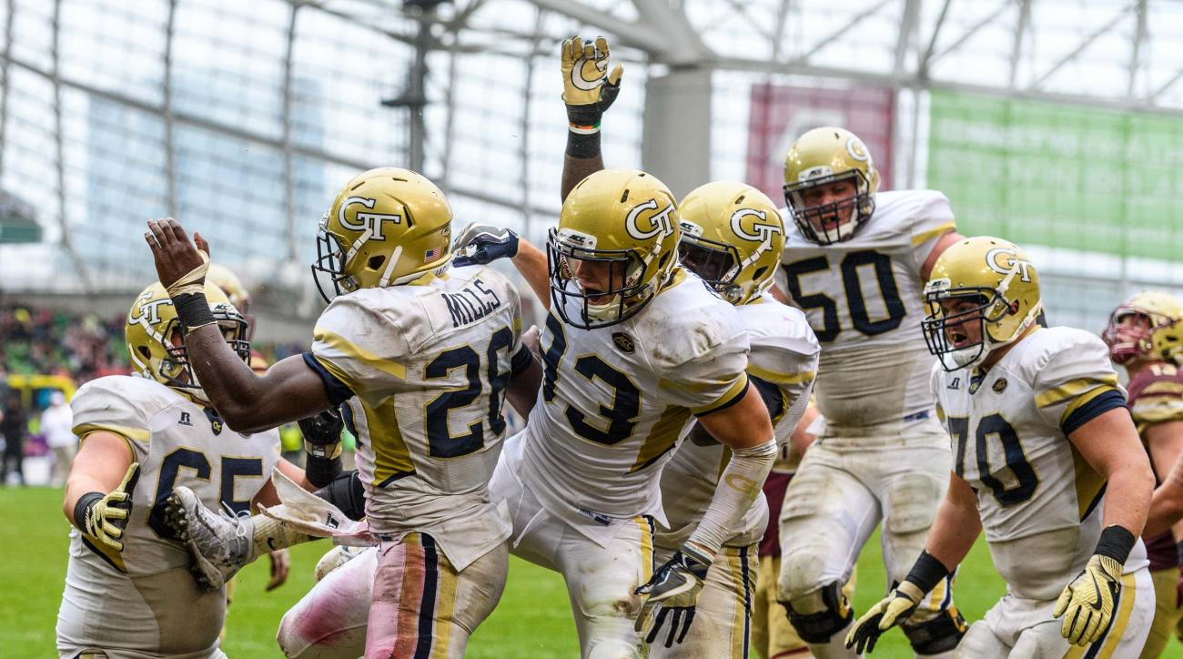 In this photo provided by Georgia Tech, Georgia Tech running back Dedrick Mills (26) celebrates with teammates after scoring a touchdown against Boston College during the second half of an NCAA college football game, Saturday, Sept. 3, 2016, in Dublin. Ge