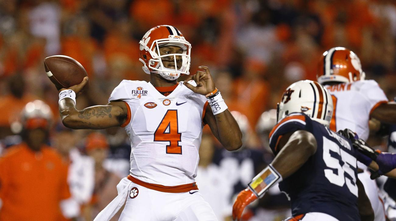 Clemson quarterback Deshaun Watson, looks to throw during the first half of an NCAA college football game against Auburn, Saturday, Sept. 3, 2016, in Auburn, Ala. (AP Photo/Brynn Anderson)