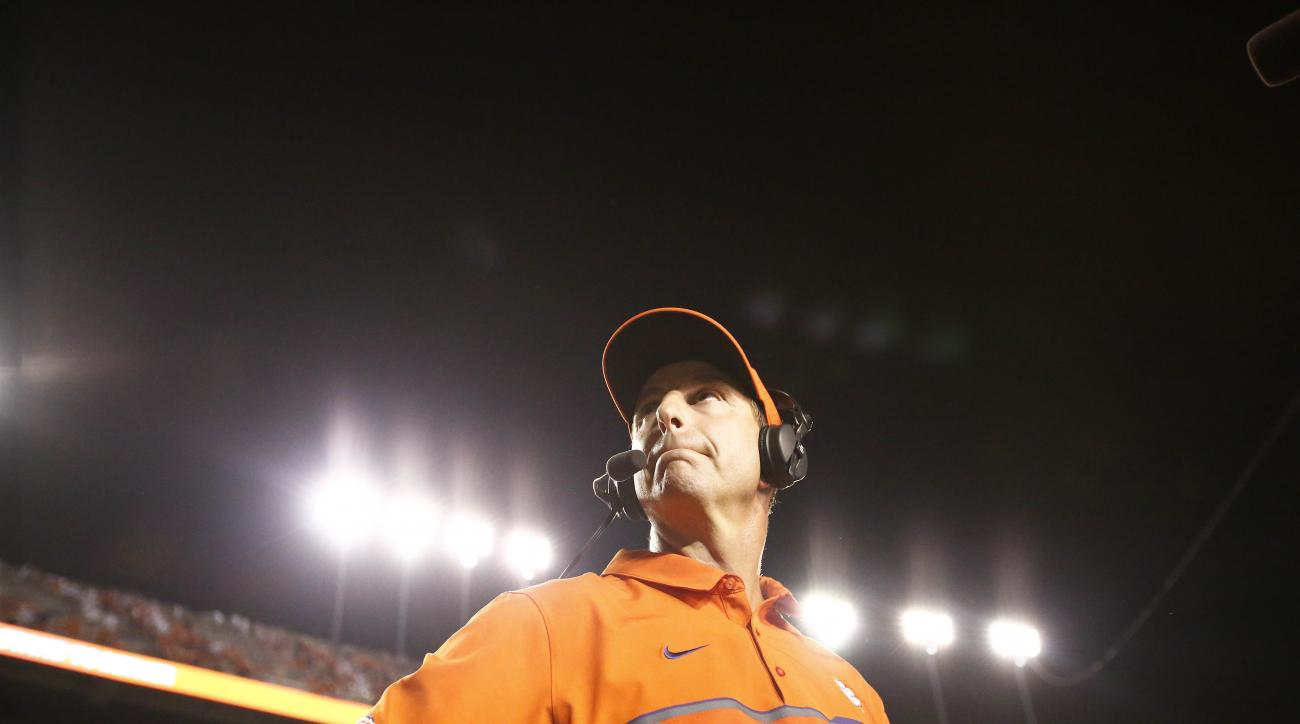 Clemson coach Dabo Swinney looks at the scoreboard after Clemson's 19-13 win over Auburn an NCAA college football game, Saturday, Sept. 3, 2016, in Auburn, Ala. (AP Photo/Brynn Anderson)