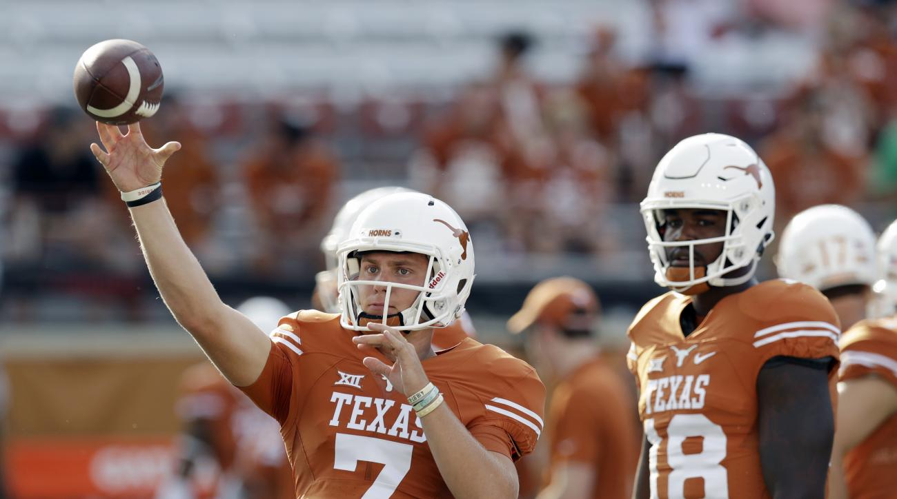 Texas quarterback Shane Buechele (7) and quarterback Tyrone Swoopes (18) warm up before an NCAA college football game against Notre Dame, Sunday, Sept. 4, 2016, in Austin, Texas. (AP Photo/Eric Gay)