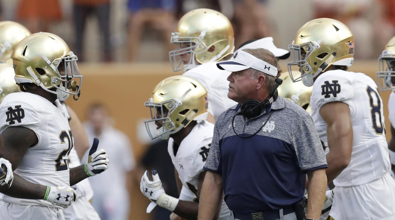 Notre Dame head coach Brian Kelly, center, watches as his players run off the field during the first half of an NCAA college football game against Texas , Sunday, Sept. 4, 2016, in Austin, Texas. (AP Photo/Eric Gay)
