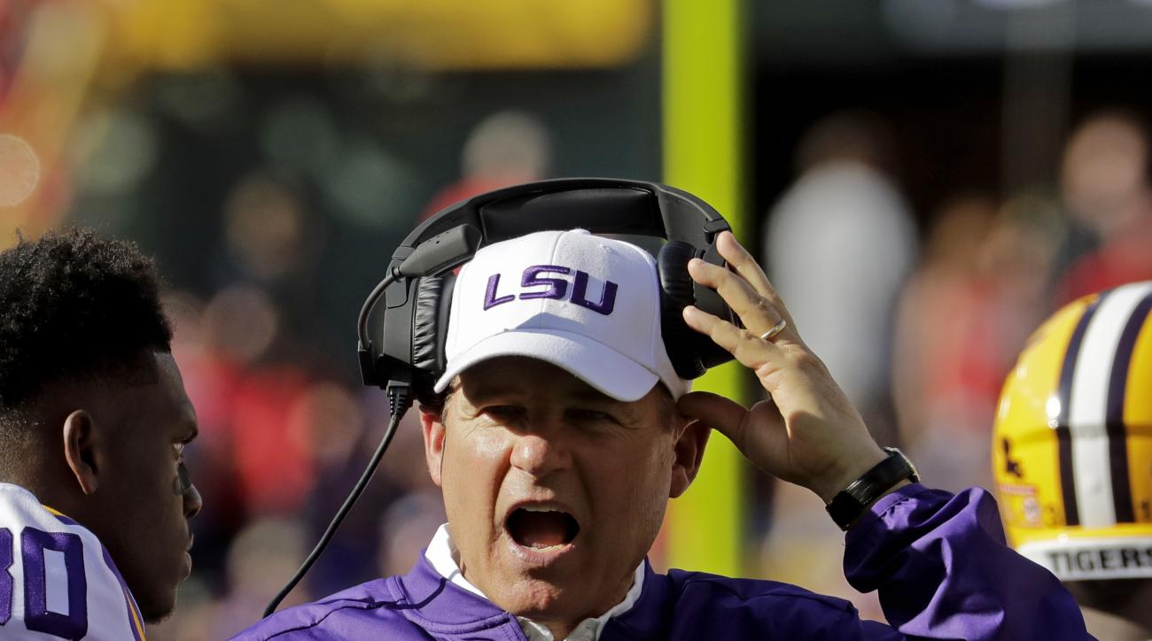 FILE - In this Sept. 3, 2016, file photo, LSU head coach Les Miles yells during the second half of an NCAA college football game against Wisconsin, in Green Bay, Wis. After being upset by unranked Wisconsin, Miles is facing questions about his stagnant of