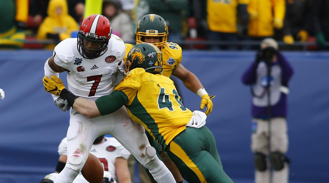 Jacksonville State quarterback Eli Jenkins (7) fumbles as he is hit by linebacker Nick DeLuca (49) in the second half of the FCS championship NCAA college football game, Saturday, Jan. 9, 2016, in Frisco, Texas.  North Dakota State beat Jacksonville State