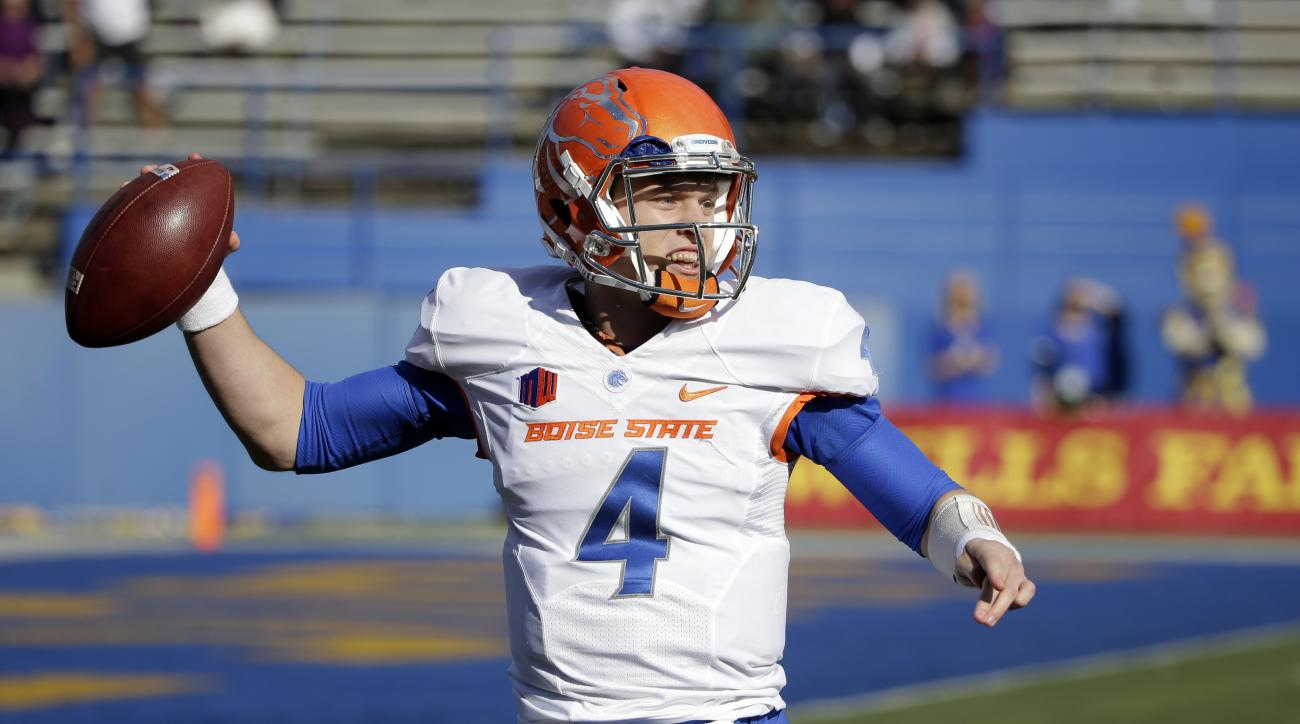 FILE -- In this Nov. 27, 2015, file photo, Boise State quarterback Brett Rypien throws against San Jose State during an NCAA college football game in San Jose, Calif. Brett Rypien opted not to follow the path of his Super Bowl MVP uncle Mark when it came