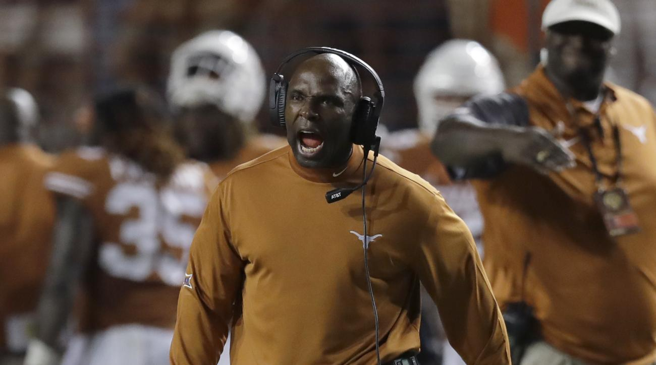 FILE - In this Sept. 4, 2016, file photo, Texas head coach Charlie Strong calls to his players during the second half of an NCAA college football game against Notre Dame, in Austin, Texas. One weekend has already changed the tone of the Big 12, and teams