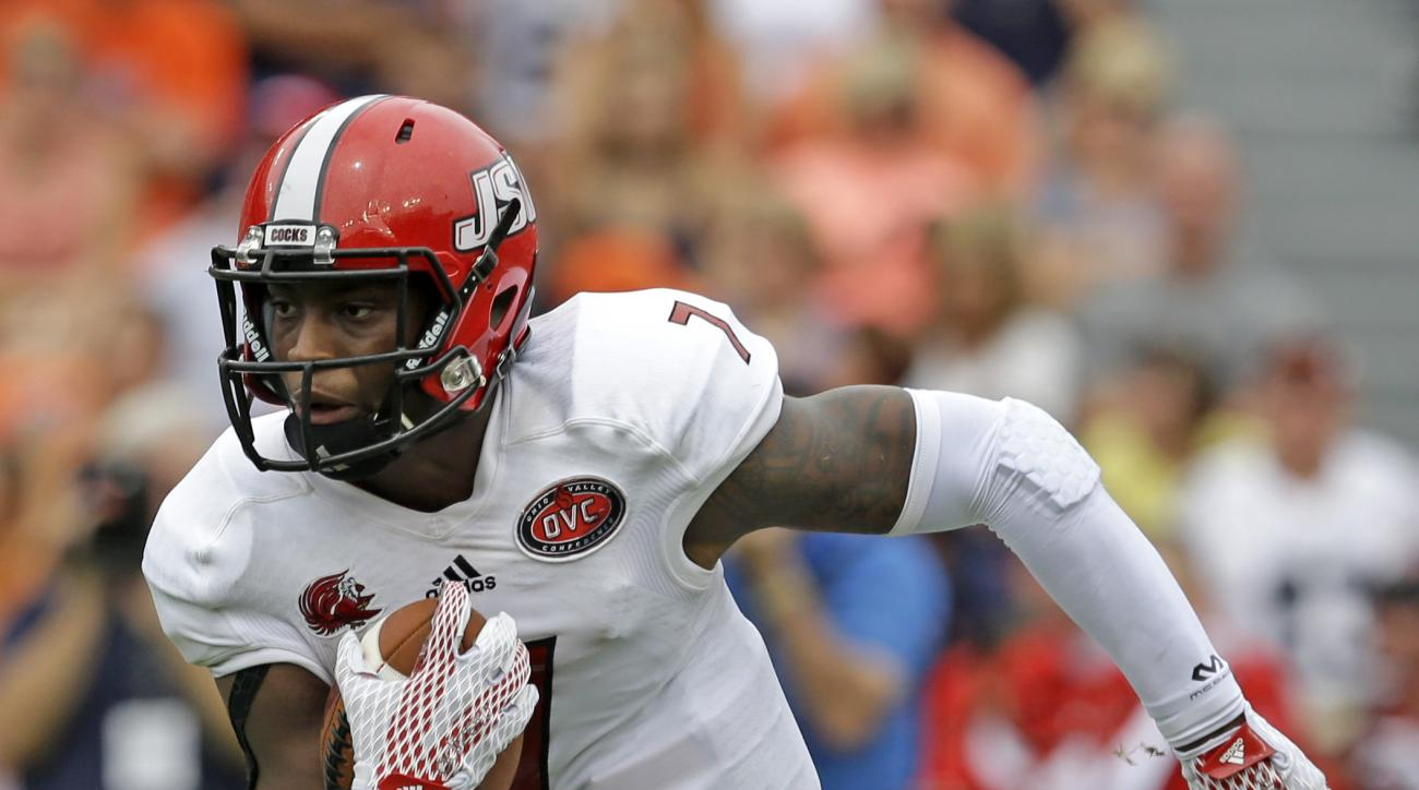 Jacksonville State quarterback Eli Jenkins (7) carries the ball for a first down during the first half of an NCAA college football game against Auburn, Saturday, Sept. 12, 2015, in Auburn, Ala. (AP Photo/Butch Dill)