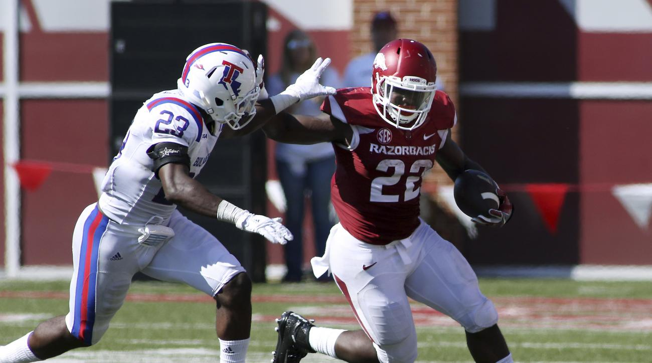 FILE - In this Sept. 3, 2016, file photo, Arkansas' Rawleigh Williams III (22) pushes off Louisiana Tech's Prince Sam during an NCAA football game in Fayetteville, Ark. Arkansas plays TCU this week. The style matchup could provide some intrigue. Bret Biel