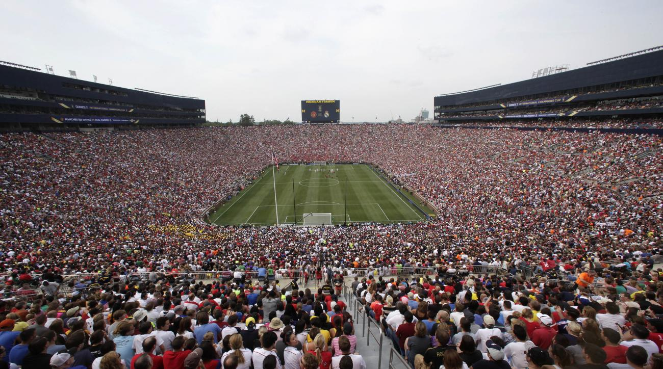 FILE - In this Aug. 2, 2014, file photo, Real Madrid plays Manchester United during a Guinness International Champions Cup soccer match at Michigan Stadium in Ann Arbor, Mich. Michigan Stadium was the scene of the highest-attended soccer match in the Unit
