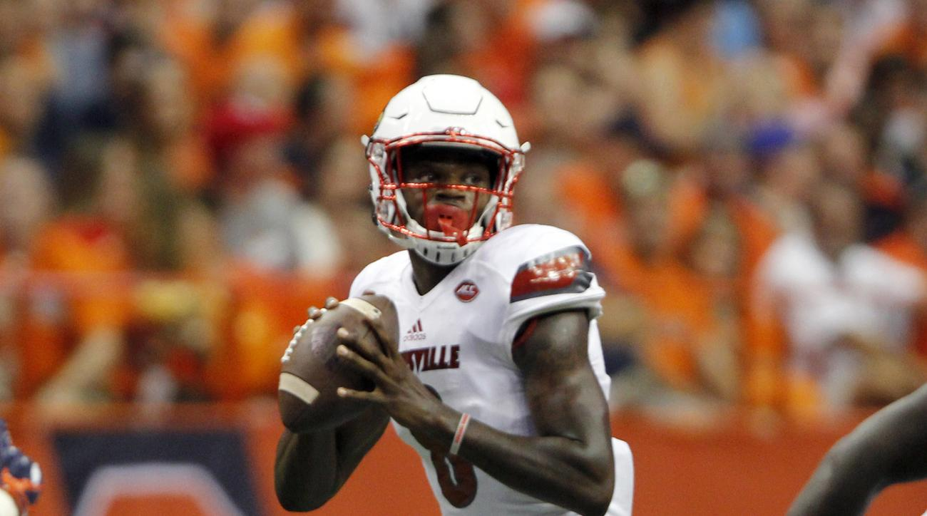 Louisville's Lamar Jackson looks to pass the ball in the first half of an NCAA college football game against Syracuse in Syracuse, N.Y., Friday, Sept. 9, 2016. (AP Photo/Nick Lisi)