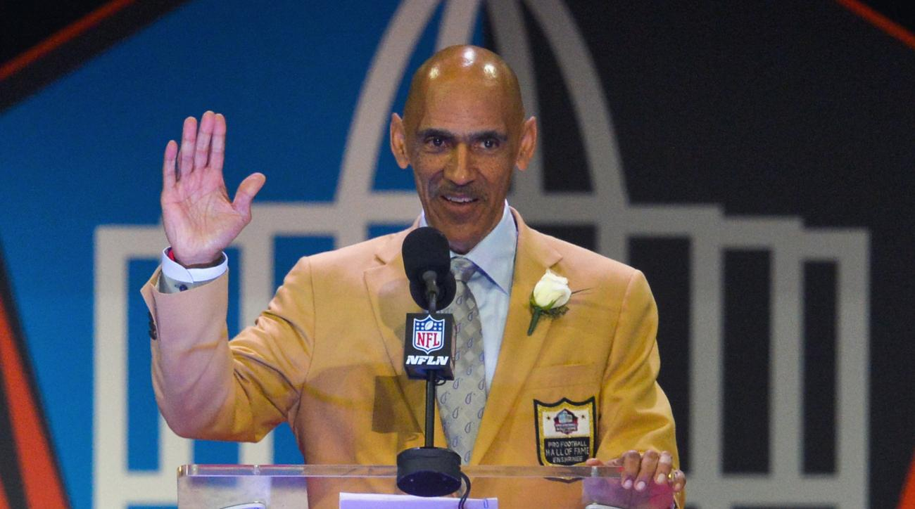 FILE - In this Aug. 6, 2016, file photo, former NFL player and coach Tony Dungy delivers a speech during an induction ceremony at the Pro Football Hall of Fame in Canton, Ohio. Dungy was part of South Floridas pitch to the Big 12 and former major league f