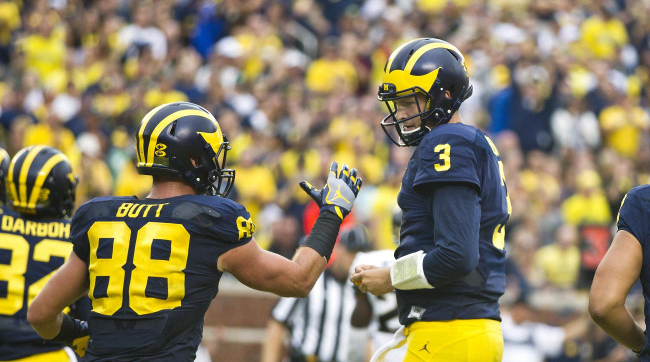 Michigan tight end Jake Butt (88) celebrates his touchdown catch thrown by quarterback Wilton Speight (3) in the second quarter of an NCAA college football game against Central Florida at Michigan Stadium in Ann Arbor, Mich., Saturday, Sept. 10, 2016. (AP