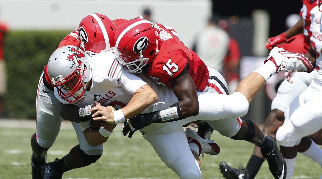 Nicholls quarterback Chase Fourcade (9) is tackled by Georgia linebackers Roquan Smith and D'Andre Walker (15) in the first half of an NCAA college football game Saturday, Sept. 10, 2016, in Athens, Ga. (AP Photo/Brett Davis)