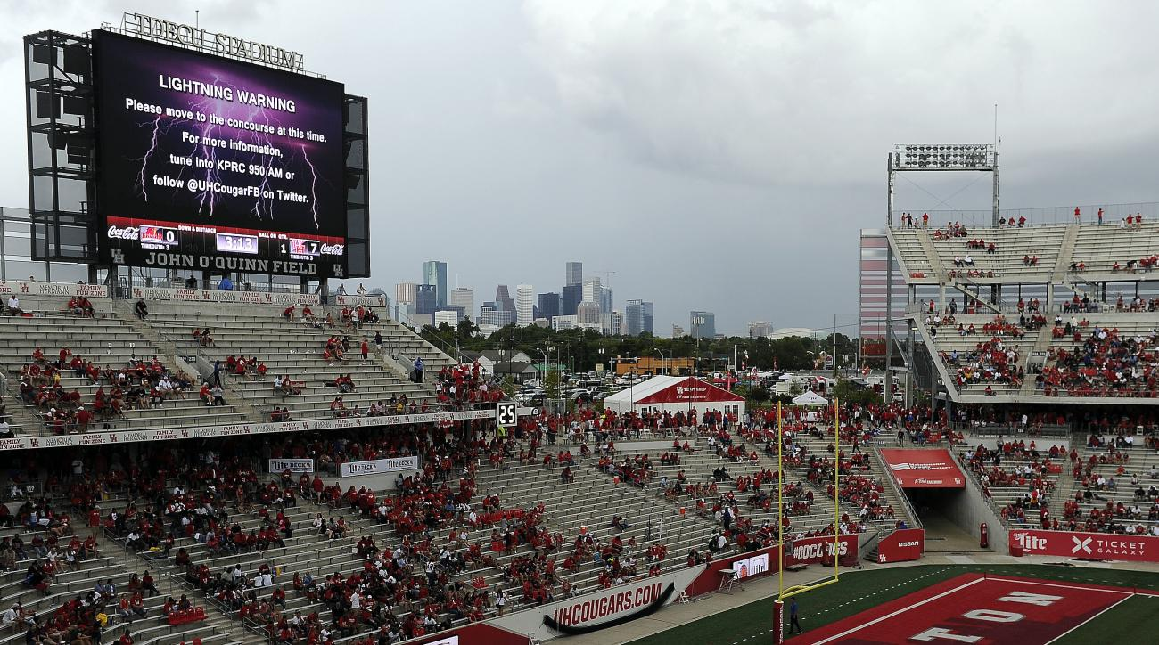 Fans wait out a weather delay in the first half of an NCAA college football game between Houston and Lamar , Saturday, Sept. 10, 2016, in Houston. (AP Photo/Eric Christian Smith)