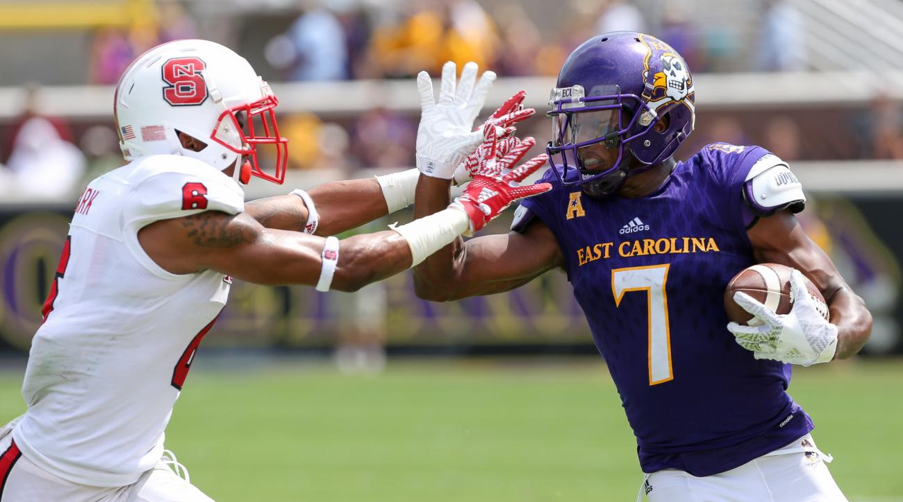 East Carolina's Zay Jones, right, fights off North Carolina State's Dravious Wright during the first half of an NCAA college football game in Greenville, N.C. on Saturday, Sept. 10, 2016. in Greenville, N.C. (Rhett Butler /The Daily Reflector via AP)