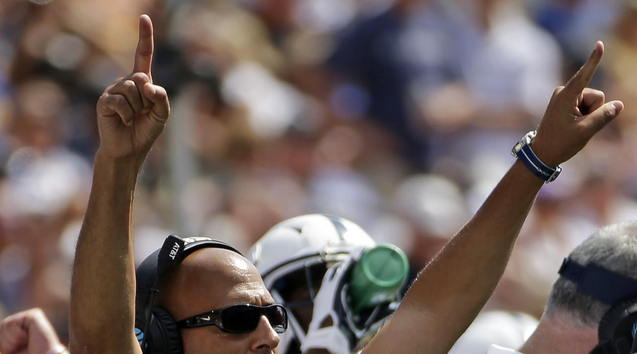 Penn State head coach James Franklin celebrates a Penn State touchdown during the first half of an NCAA college football game against Pittsburgh in Pittsburgh, Saturday, Sept. 10, 2016. (AP Photo/Gene J. Puskar)