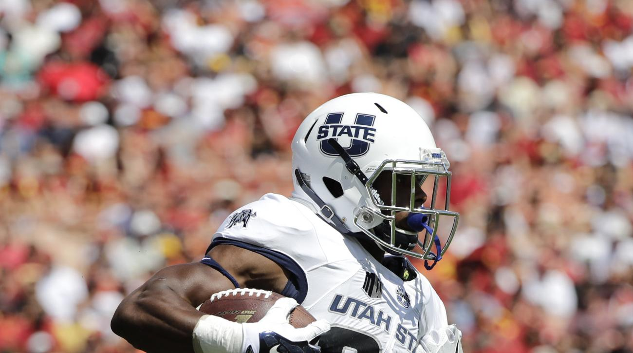 Southern California defensive back Marvell Tell III, right, pulls the jersey of Utah State running back Justen Hervey during the first half of an NCAA college football game, Saturday, Sept. 10, 2016, in Los Angeles. (AP Photo/Jae C. Hong)
