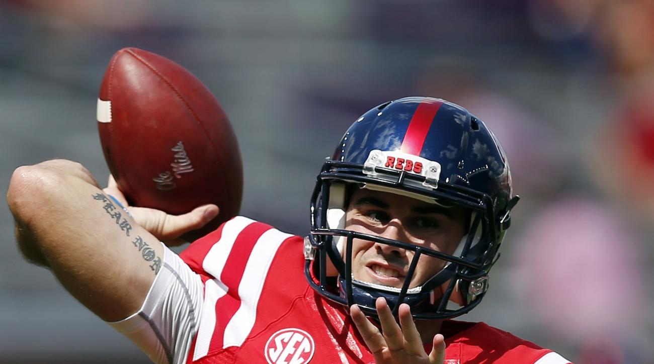 Mississippi quarterback Chad Kelly (10) tosses passes as he warms up before playing in an NCAA college football game against Wofford in Oxford, Miss., Saturday, Sept. 10, 2016. (AP Photo/Rogelio V. Solis)