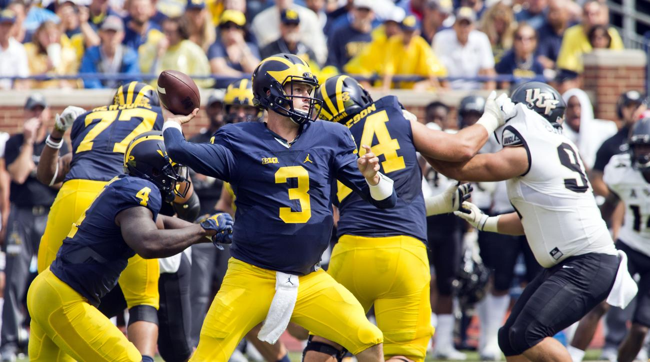Michigan quarterback Wilton Speight (3) throws a pass in the third quarter of an NCAA college football game against Central Florida at Michigan Stadium in Ann Arbor, Mich., Saturday, Sept. 10, 2016. Michigan won 51-14. (AP Photo/Tony Ding)