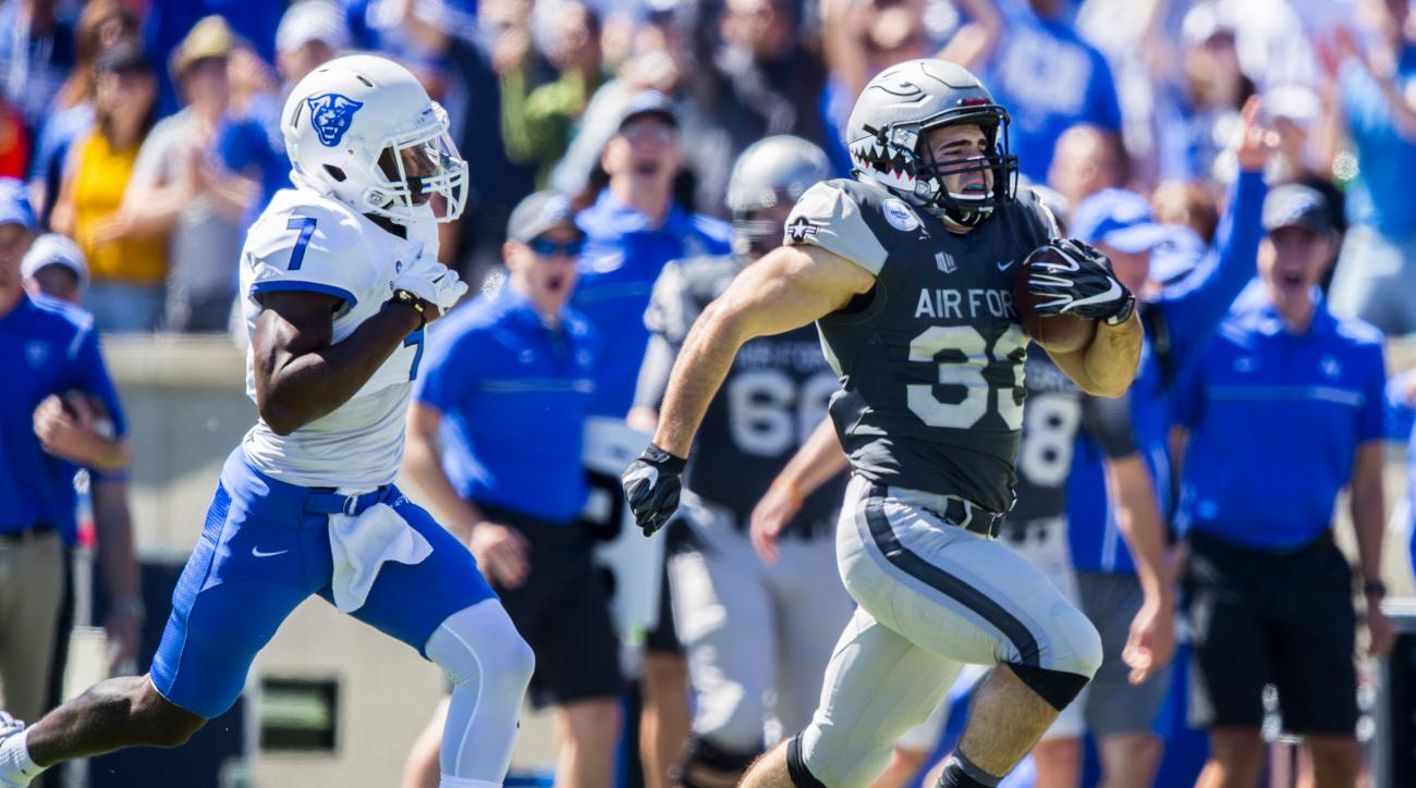 Air Force's Tim McVey returns a kick off past Georgia State's Robert Dowling for a touchdown during the first quarter of an NCAA college football game, Saturday, Sept. 10, 2016, at Falcon Stadium on Air Force Academy in Colorado Springs, Colo. (Christian