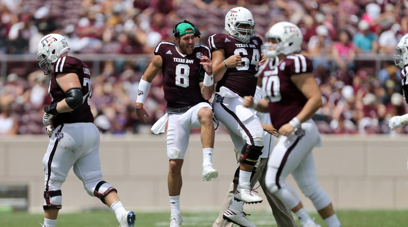 Texas A&M quarterback Trevor Knight (8) celebrates a field goal with teammate Erik McCoy (64) during the second half of an NCAA college football game against Prairie View A&M Saturday, Sept. 10, 2016, in College Station, Texas. (AP Photo/Sam Craft)