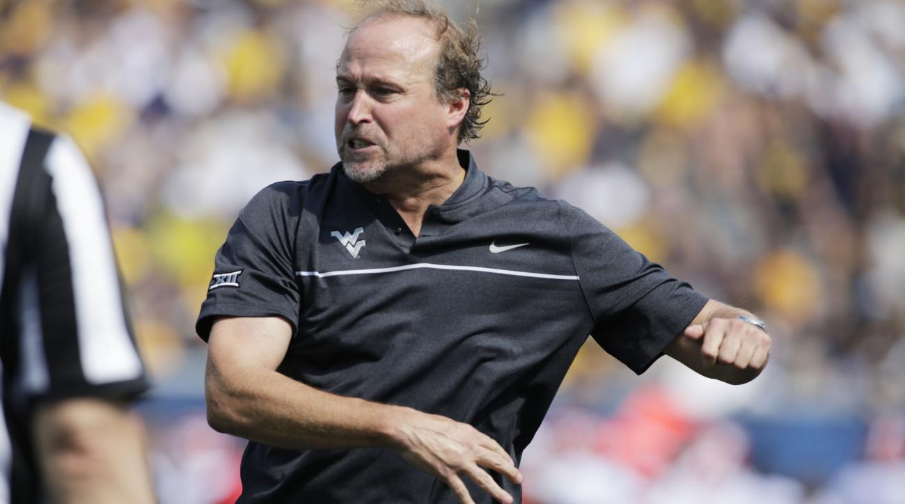 West Virginia head coach Dana Holgorsen screams at the referee during the first half of an NCAA college football game, Saturday, Sept. 10, 2016, in Morgantown, W.Va. (AP Photo/Raymond Thompson)