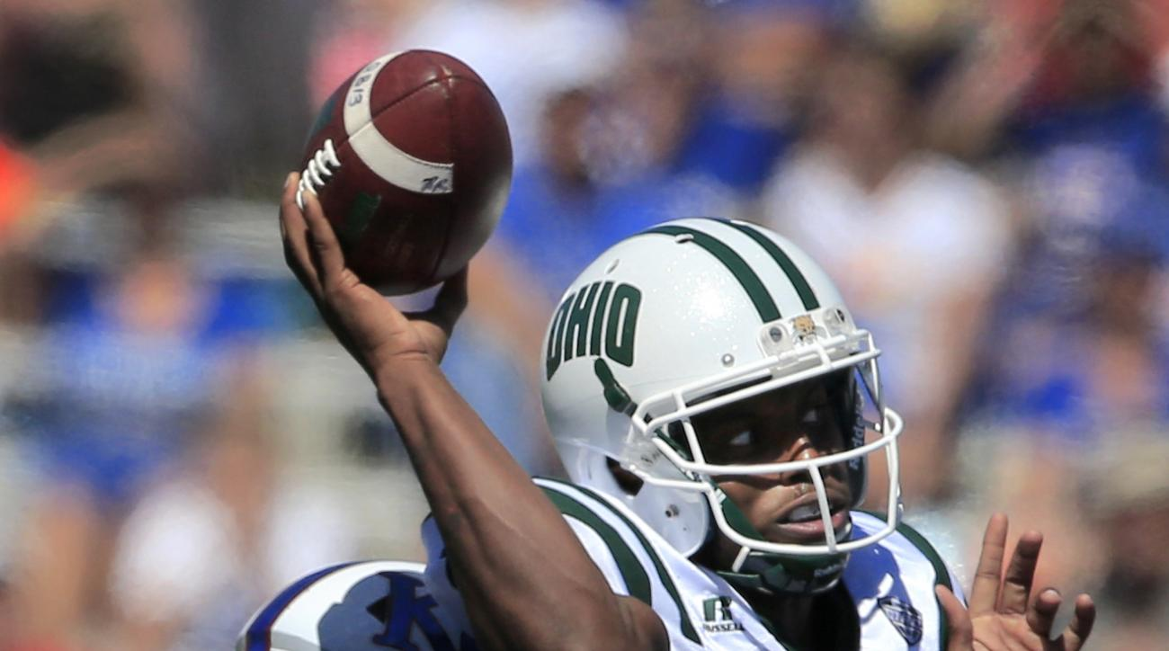 Ohio quarterback Greg Windham (14) throws under pressure by Kansas linebacker Joe Dineen Jr. (29) during the first half of an NCAA college football game in Lawrence, Kan., Saturday, Sept. 10, 2016. (AP Photo/Orlin Wagner)