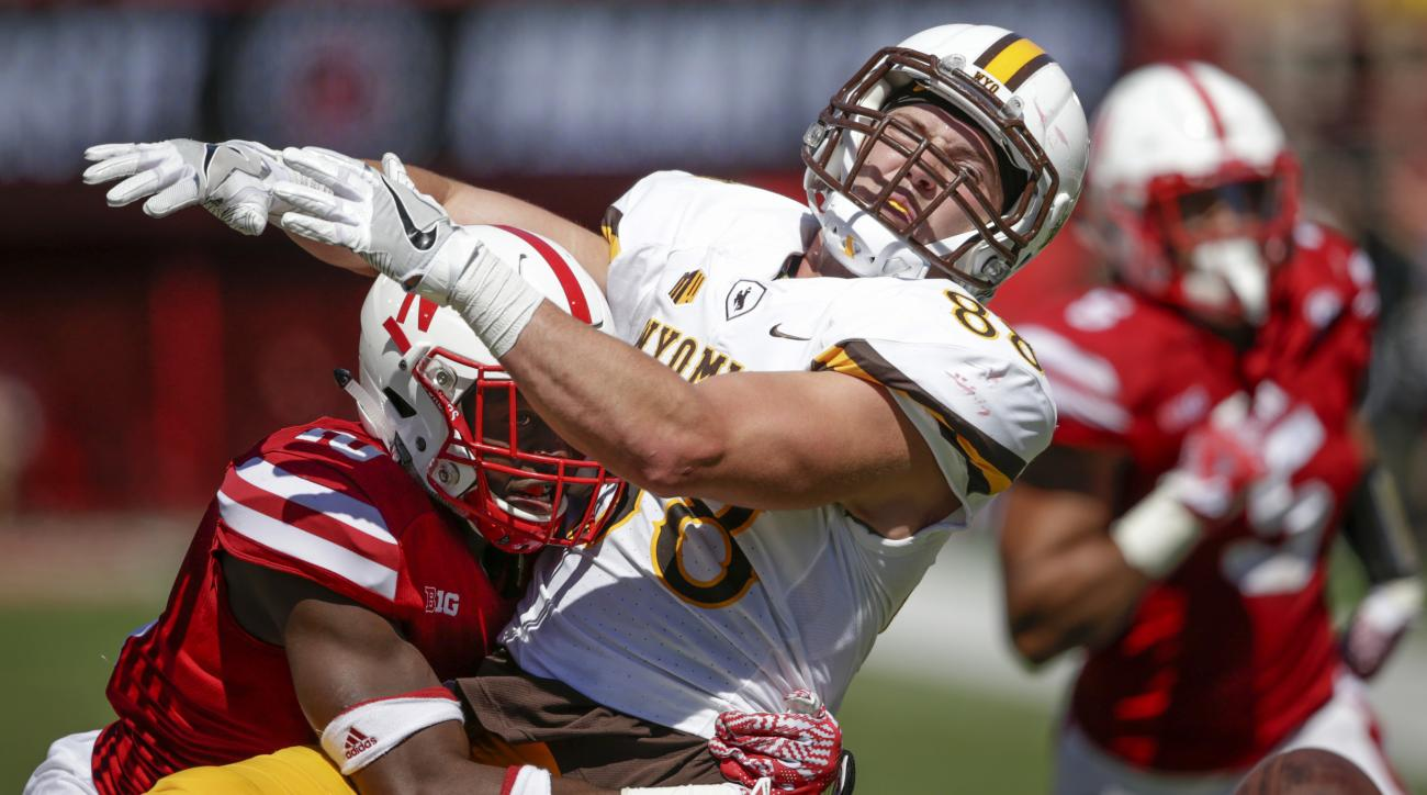 Nebraska cornerback Joshua Kalu (10) grabs Wyoming tight end Jacob Hollister (88) in what was ruled pass interference during the second half of an NCAA college football game in Lincoln, Neb., Saturday, Sept. 10, 2016. Nebraska won 52-17. (AP Photo/Nati Ha