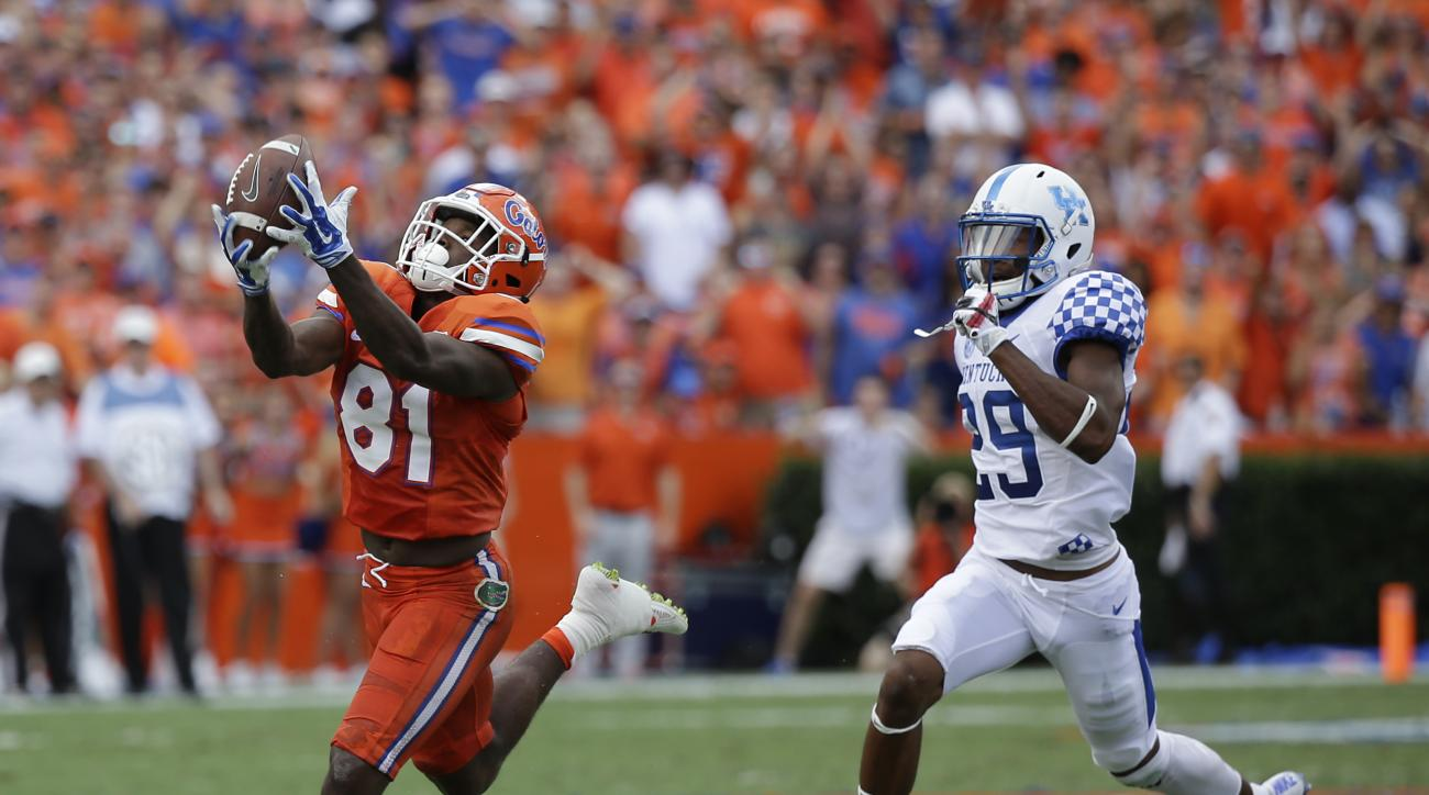 Florida wide receiver Antonio Callaway (81) catches a pass in front of Kentucky cornerback Derrick Baity (29) for a 78-yard touchdown pass play in the first half of an NCAA college football game, Saturday, Sept. 10, 2016, in Gainesville, Fla. (AP Photo/Jo