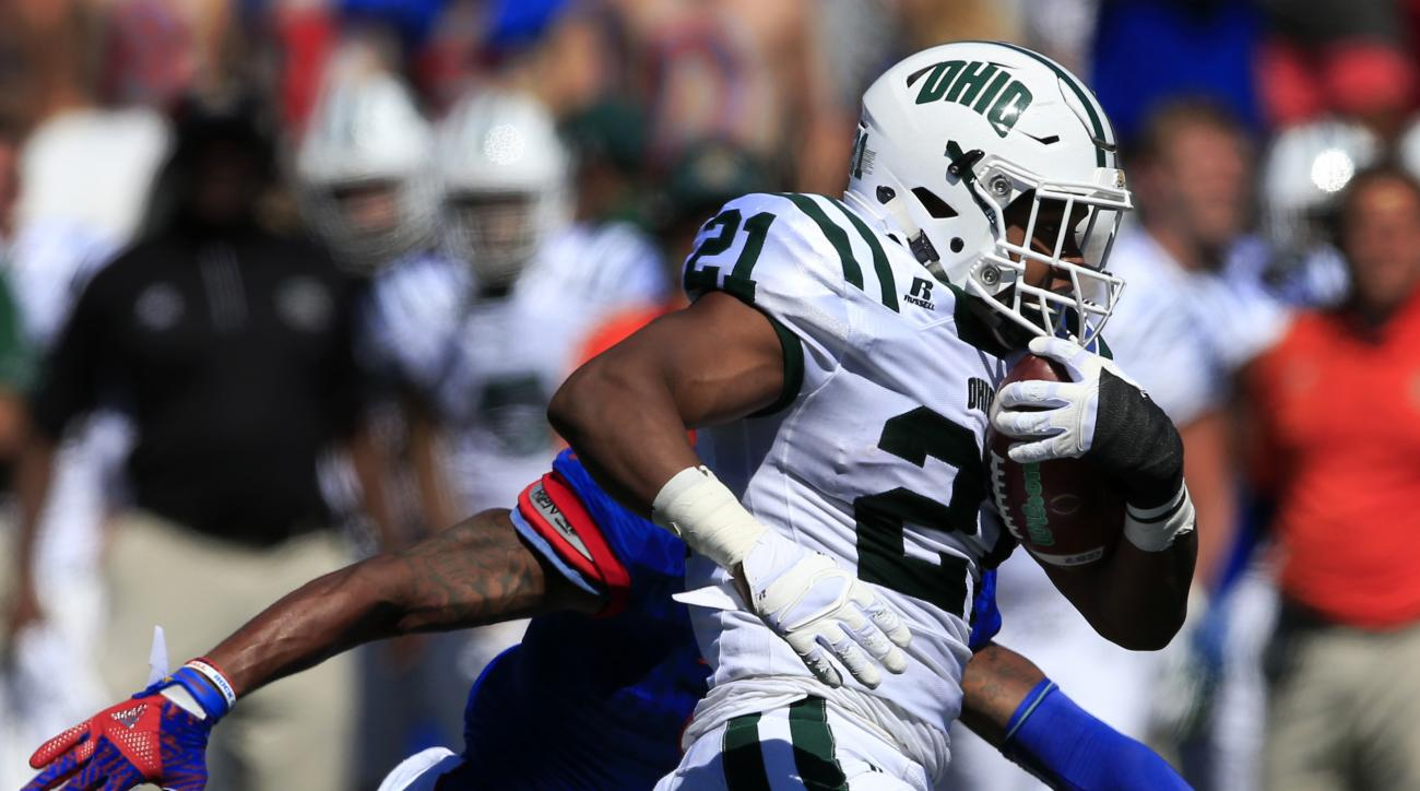 Ohio running back Maleek Irons (21) runs past Kansas safety Fish Smithson, back, during the first half of an NCAA college football game in Lawrence, Kan., Saturday, Sept. 10, 2016. (AP Photo/Orlin Wagner)