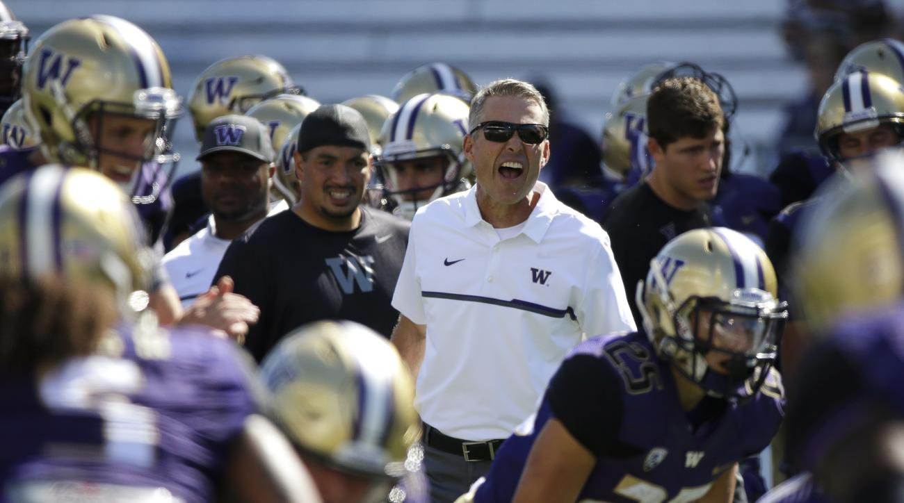 Washington head coach Chris Petersen calls to his team during warmups before an NCAA college football game against Idaho, Saturday, Sept. 10, 2016, in Seattle. (AP Photo/Ted S. Warren)