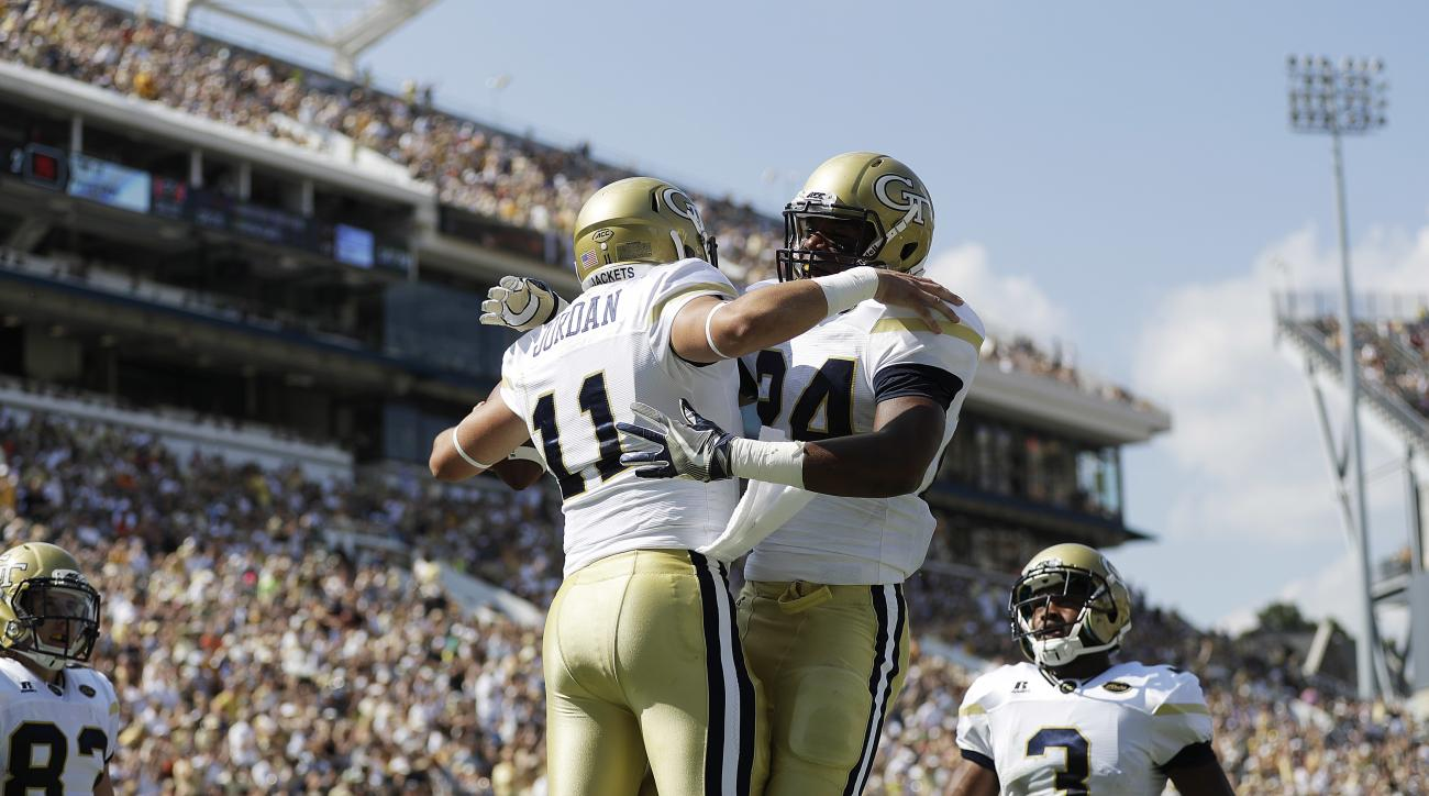 Georgia Tech quarterback Matthew Jordan, left, celebrates with teammate Marcus Allen after running the ball for a touchdown in the first half of an NCAA college football game against Mercer in Atlanta, Saturday, Sept. 10, 2016. (AP Photo/David Goldman)