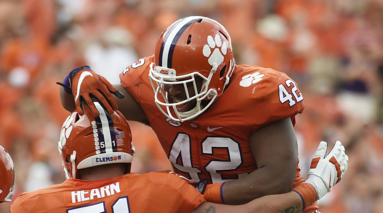 Clemson defensive lineman Christian Wilkins (42) celebrates after scoring a touchdown against Troy with teammate Clemson offensive lineman Taylor Hearn (51) during the second half an NCAA college football game on Saturday, Sept. 10, 2016, in Clemson, S.C.