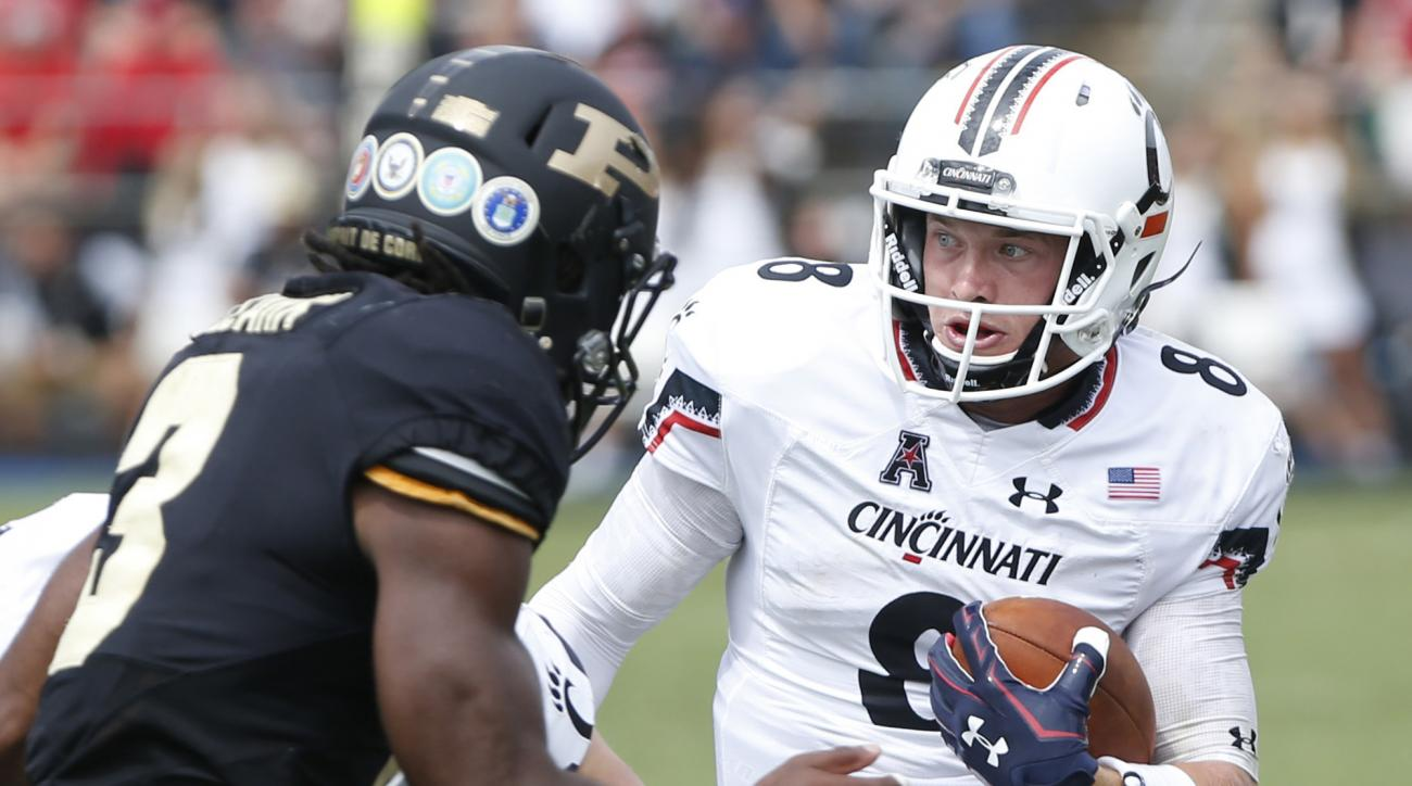 Cincinnati quarterback Hayden Moore runs against Purdue during an NCAA college football game Saturday, Sept. 10, 2016, in West Lafayette, Ind. Cincinnati defeated Purdue 38-20. (John Terhune/Journal & Courier via AP)
