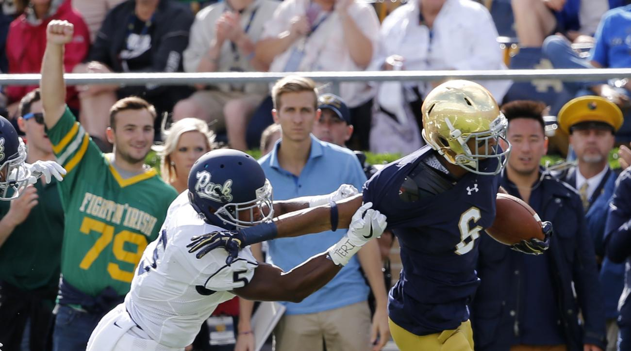 Notre Dame wide receiver Equanimeous St. Brown, right, is pushed out of bounds by Nevada defensive back Dameon Baber during the first half of an NCAA college football game Saturday, Sept. 10, 2016, in South Bend, Ind. (AP Photo/Charles Rex Arbogast)