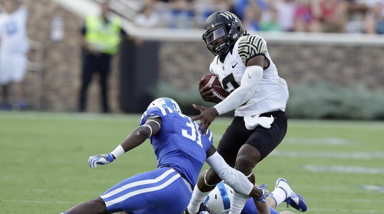 Wake Forest quarterback Kendall Hinton runs the ball as Duke's Breon Borders (31) tries to tackle during the second half of an NCAA college football game in Durham, N.C., Saturday, Sept. 10, 2016. Wake Forest won 24-14. (AP Photo/Gerry Broome)