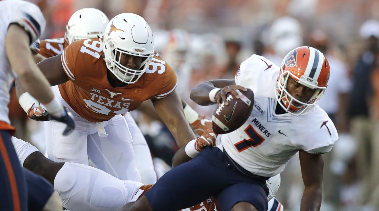 UTEP quarterback Kavika Johnson (7) is sacked by Texas linebacker Malcolm Roach (32) during the first half of a NCAA college football game, Saturday, Sept. 10, 2016, in Austin. (AP Photo/Eric Gay)