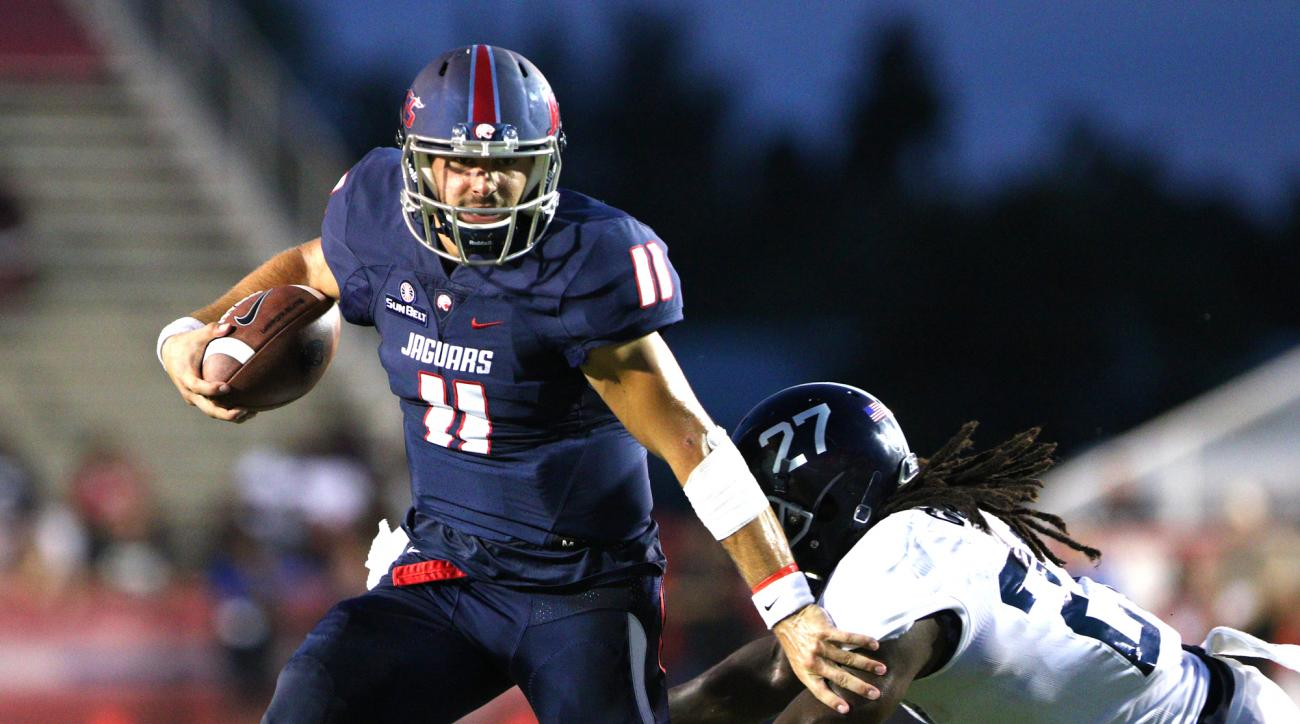 South Alabama quarterback Dallas Davis (11) pushes away from Georgia Southern linebacker Ironhead Gallon (27) during the first half of an NCAA college football game Saturday, Sept. 10, 2016, in Mobile, Ala. (Mike Kittrell/AL.com via AP)