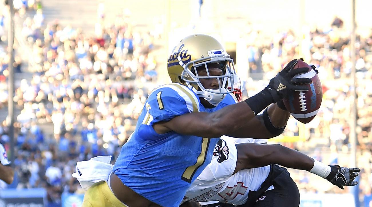 UCLA wide receiver Ishmael Adams, top, reaches for more yardage while being tackled by UNLV defensive back Darius Mouton during the first half of a college football game, Saturday, Sept. 10, 2016, in Pasadena, Calif. (AP Photo/Mark J. Terrill)