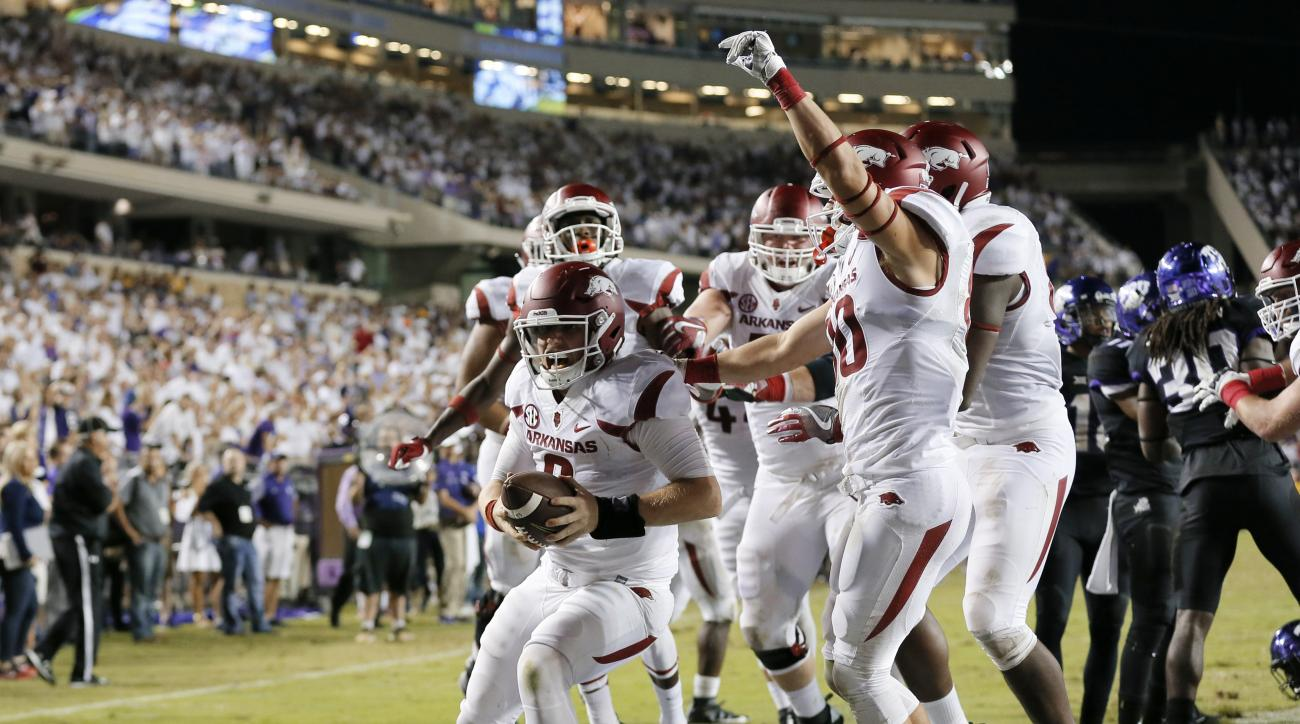Arkansas quarterback Austin Allen (8) celebrates his touchdown run with teammates in double overtime against TCU in the 41-38 Arkansas win in an NCAA college football game, Saturday, Sept. 10, 2016, in Fort Worth, Texas. (AP Photo/Tony Gutierrez)
