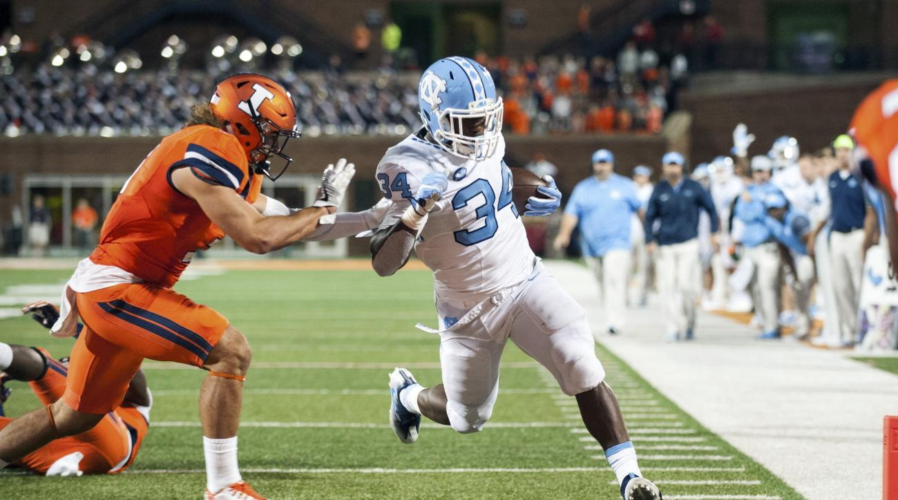 North Carolina running back Elijah Hood (34) reaches the end zone past Illinois defensive back Taylor Barton (3) during the second half of an NCAA college football game Saturday, Sept. 10, 2016 at Memorial Stadium in Champaign, Ill.  (AP Photo/Bradley Lee